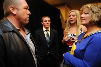 Dwayne Palmer, left, Collin Palmer, Tess Sito, and Jane Sito, talk at the Greater Cleveland Sports Awards Feb. 3.   Steve Manheim