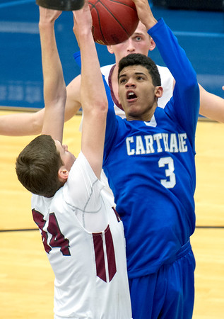 Carthage's Arkell Smith (3) puts up a shot as Nevada's Patrick Ferry (34) during their semifinal game of the Carthage High School Invitational on Friday night at CHS.<br /> Globe | Laurie Sisk