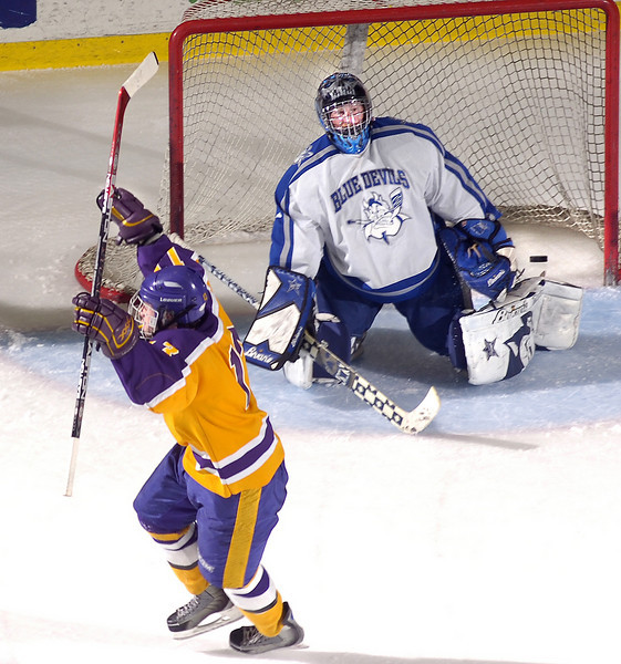 TWO YEARS IN A ROW:<br /> Chevrus forward Todd Keneborus celebrates what turned out to be the game winning goal as Lewiston goalie Brian Nason can only look on in disbelief as Chevrus took a 2-1 lead and eventually went on to a 3-1 victory to capture the Class A State Hockey Championship in front of a capacity crowd at the Colisee in Lewiston.