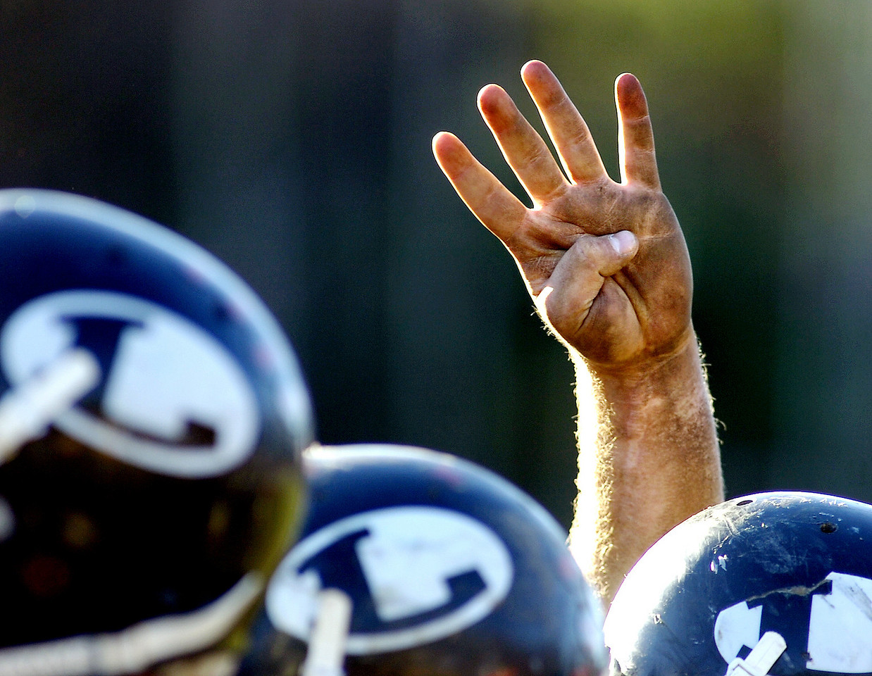 SPORTS DETAILS:<br /> The dirty hand of a Lisbon player signals the start of the fourth quarter of Saturday's game in Lisbon.  The Greyhounds outran the Seahawks to advance to next week's state championship game in Portland.