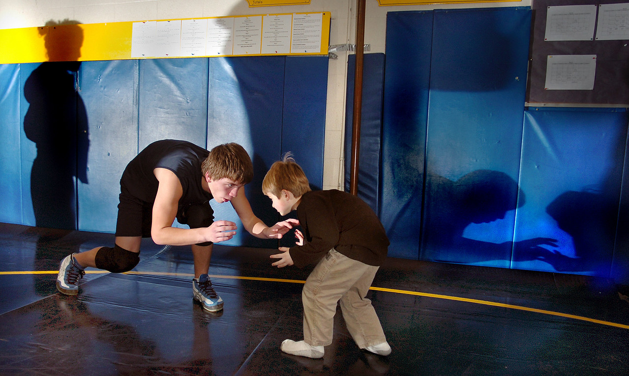 Lowell Trahan, 5, of Farmington doesn't let a little size differential intimidate him as he wrestles with Mt. Blue sophomore Jon Iams after Friday's practice in the Cave at the school where Lowell's father is an assistant coach of the wrestling team.  The young grappler competes in the summer youth program where he has already wrestled in a number of tournaments.