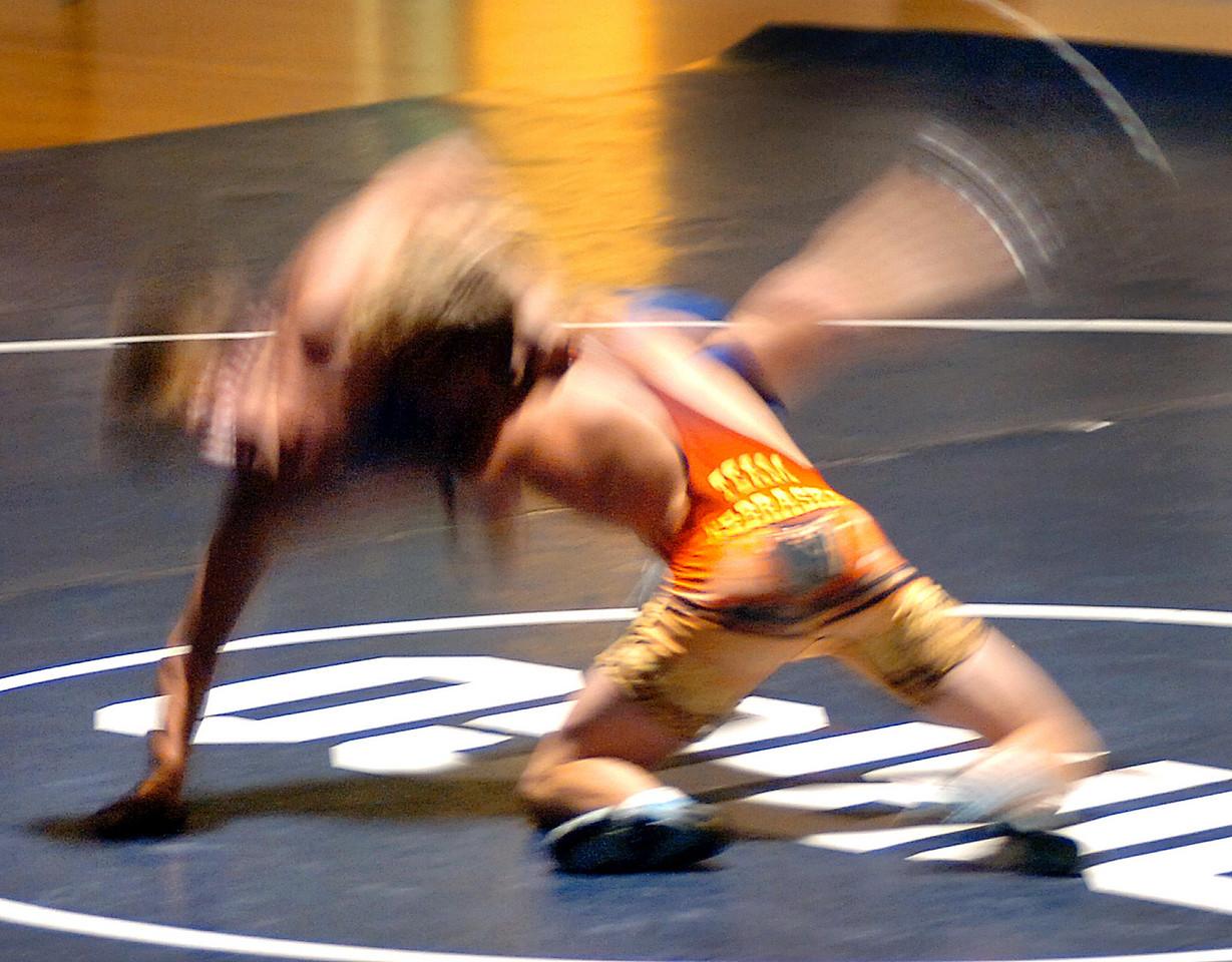Dirigo's Derek Daley, left is taken down by Nebraska's Jon Crocker during the 135 lbs. class match at Dirigo High School during the 23 Maine vs Nebraska wrestling Exchange.  Crocker won the match.