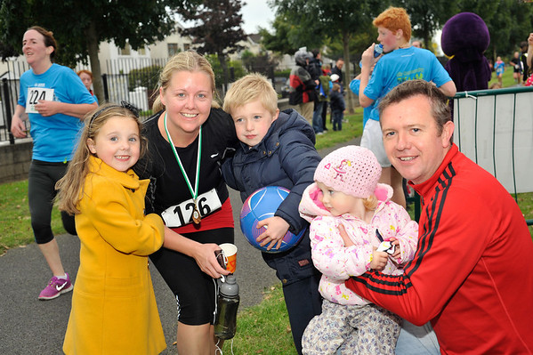 Image features The McGrane Family congratulating their Mammy Tracy  after she finished the race.<br /> dlr Community 5K, took place on Saturday 12th October 2013 at 2pm in Kilbogget Park, Ballybrack.<br /> Now in its 5th year, this family fun event brings together the whole community: people of all ages and abilities. Once again kicking off Social Inclusion Week, all fitness levels were welcome where you can walk, jog, run, wheel or push a buggy.<br /> The 5-kilometre route took participants around the picturesque Kilbogget Park and was suitable for all levels of ability and fitness.  This annual event is organised by DLR Sports Partnership and its partners Dún Laoghaire-Rathdown County Council, dlr Leisure Services, the HSE, Cabinteely Athletic and Football Clubs and Sallynoggin College.<br /> For further information contact Dún Laoghaire-Rathdown Sports Partnership Tel. 01-2719502