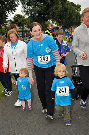 Isabelle and Ewen, with Natalie O'Boyle finishing the race.<br /> dlr Community 5K, took place on Saturday 12th October 2013 at 2pm in Kilbogget Park, Ballybrack.<br /> Now in its 5th year, this family fun event brings together the whole community: people of all ages and abilities. Once again kicking off Social Inclusion Week, all fitness levels were welcome where you can walk, jog, run, wheel or push a buggy.<br /> The 5-kilometre route took participants around the picturesque Kilbogget Park and was suitable for all levels of ability and fitness.  This annual event is organised by DLR Sports Partnership and its partners Dún Laoghaire-Rathdown County Council, dlr Leisure Services, the HSE, Cabinteely Athletic and Football Clubs and Sallynoggin College.<br /> For further information contact Dún Laoghaire-Rathdown Sports Partnership Tel. 01-2719502