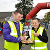 Image features Aidan & Sarah Mackey - Volunteers from Sallynoggin College helping out at the race and having a well earned break!<br /> dlr Community 5K, took place on Saturday 12th October 2013 at 2pm in Kilbogget Park, Ballybrack.<br /> Now in its 5th year, this family fun event brings together the whole community: people of all ages and abilities. Once again kicking off Social Inclusion Week, all fitness levels were welcome where you can walk, jog, run, wheel or push a buggy.<br /> The 5-kilometre route took participants around the picturesque Kilbogget Park and was suitable for all levels of ability and fitness.  This annual event is organised by DLR Sports Partnership and its partners Dún Laoghaire-Rathdown County Council, dlr Leisure Services, the HSE, Cabinteely Athletic and Football Clubs and Sallynoggin College.<br /> For further information contact Dún Laoghaire-Rathdown Sports Partnership Tel. 01-2719502