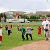8-9 year old group fielding thrown balls.<br /> <br /> Photo by Chris Rourke