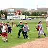 8-9 year olds fielding thrown balls<br /> <br /> Photo by Chris Rourke