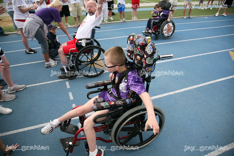 Cain Lawrence, Shelbyville, Illinois, crosses the finish line during the 25M motorized wheelchair race during the Special Olympics at O'Brien stadium at Eastern Illinois University on Friday, April 24, 2009. (Jay Grabiec)