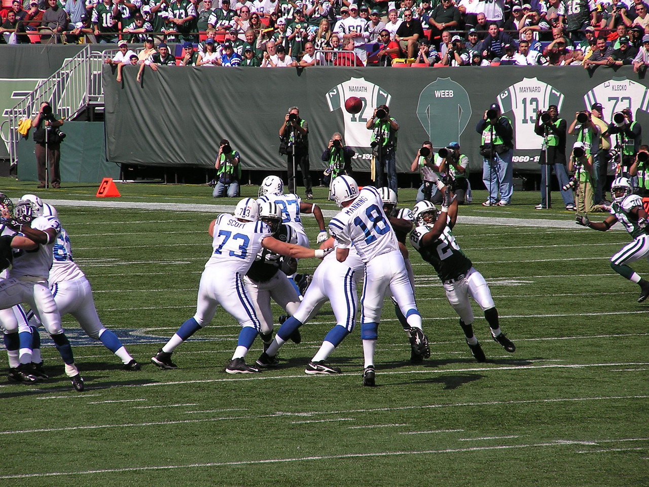Manning completing a pass