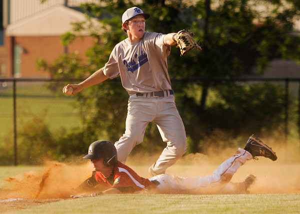 Floyds Knobs Post 42 third baseman Drew Reich tags out Madison Post 9's Ryan Hicks at third for the second out of the sixth inning during their American Legion game at Floyd Central High School on Tuesday evening. Staff photo by Christopher Fryer