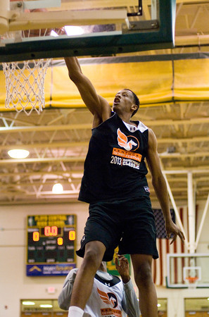 Indiana University recruit Troy Williams dunks the ball during a two-on-two game at the Kentucky Derby Festival's Night of Future Stars at Floyd Central High School on Thursday. Staff photo by Christopher Fryer
