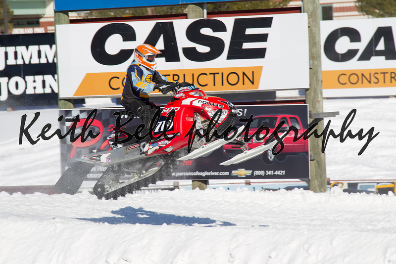 Polaris Red & Black Snowmobile Getting some Air