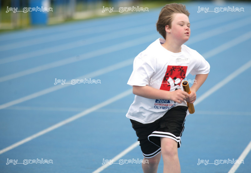 Thomas Frichtl, Effingham County Olympian, runs his leg of the 4X100M Relay race during the Special Olympics at O'Brien stadium at Eastern Illinois University on Friday, April 24, 2009. (Jay Grabiec)