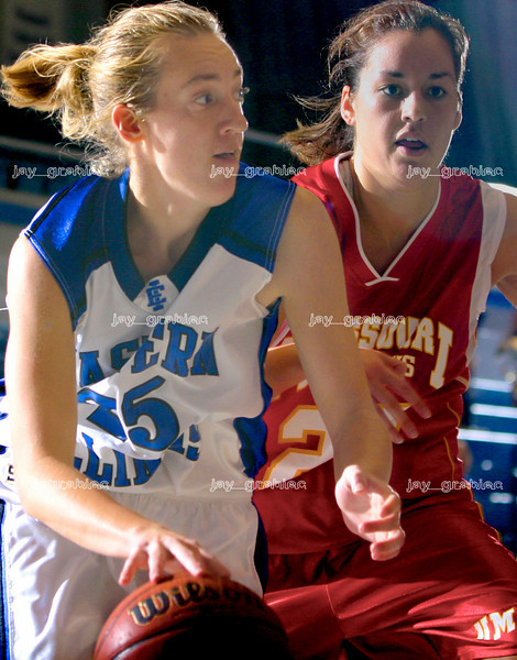 Senior gaurd Amanda Maxedon drives the baseline against University of Missouri St. Louis junior forward Taylor Gagliano on Friday November 10, 2006 at Lantz arena. (Jay Grabiec/The Daily Eastern News)