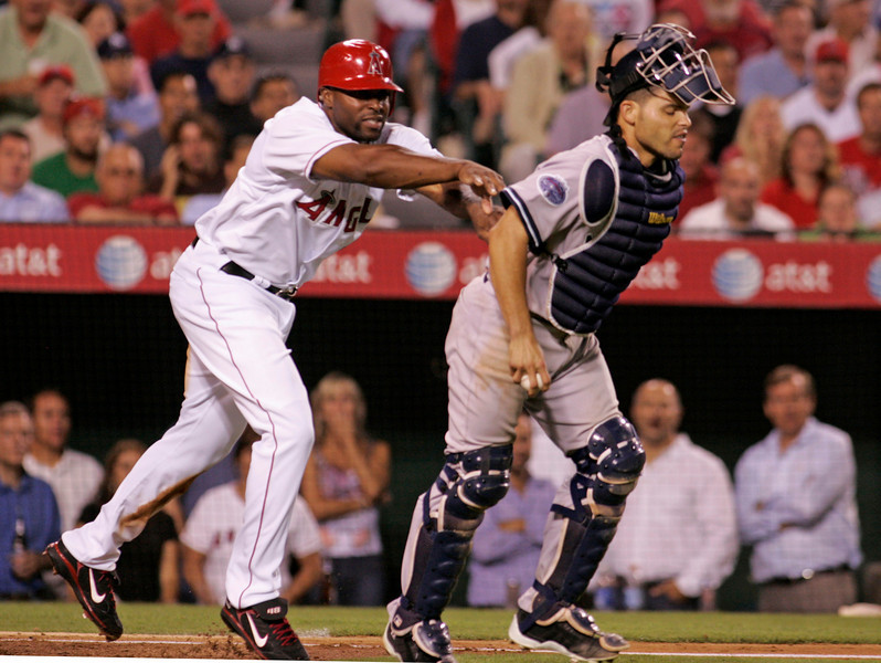 Angels, Torii Hunter shoves New York Yankees, Ivan Rodriguez in the 6th inning of play both were ejected from the game. The game was held at the Angel Stadium in Anaheim.