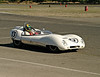 A vintage white Lotus racecar on a race track. The car was moving at speed during a road race.