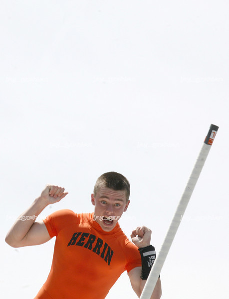 Herrin High School junior Ethan Grounds reacts in mid air after clearing the pole vault bar during Class A competition at the IHSA track and field state finals at O'Brien stadium in Charleston, Illinois on Saturday, May 24, 2008. (Jay Grabiec/Staff Photographer)
