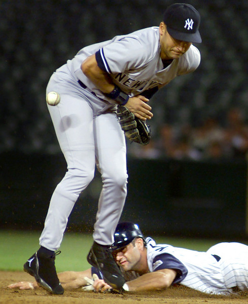 Derek Jeter cannot hold onto the ball in the first inning of play.