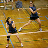 Michelle Terwilleger, St. Charles North senior, takes a shot during a doubles match against Aurora West at the IHSA badminton tournament on the student recreation center basketball courts at Eastern Illinois University on Friday, May 15, 2009. (Jay Grabiec)
