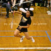 Princess Clemente, Tinely Park junior, takes a shot on the shuttle cock during a match against Jenny Lupa, Aurora West junior, at the IHSA badminton tournament on the student recreation center basketball courts at Eastern Illinois University on Friday, May 15, 2009. (Jay Grabiec)