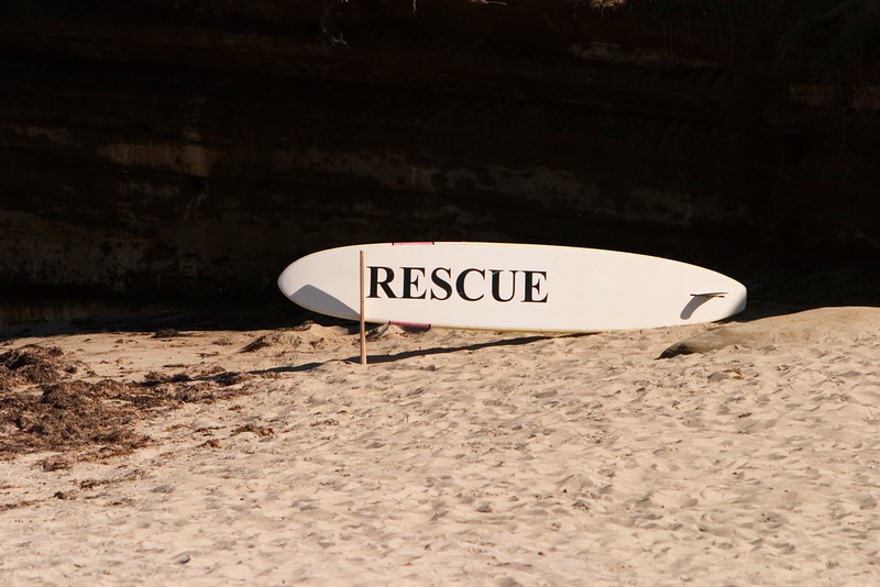 The emergency life saving equipment at the beach in La Jolla consisted of a surfboard with the Rescue sign on it.