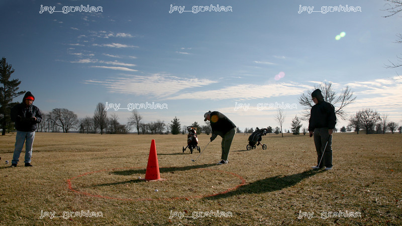 (L to R) Ron Fisher, Larry Lawson and Hardy Williams take a shot at the green during the Frozen Open event held at Rogala Public Links golf course on Route 16 west of Mattoon,  Illinois on Thursday, January 1, 2009. (Jay Grabiec)