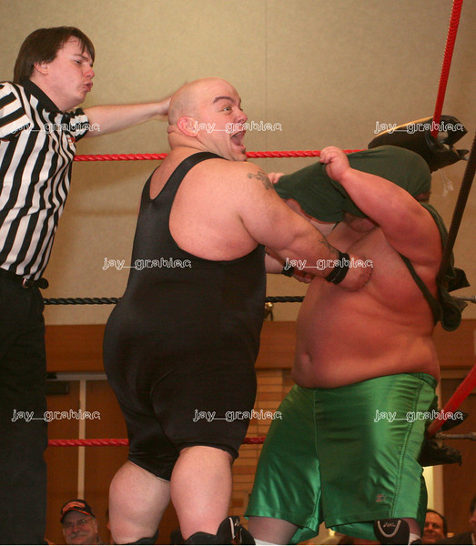 Professional wrestlers perform in the Grand Ballroom at Eastern Illinois University in Charleston, Illinois on February 17, 2007. (Jay Grabiec)