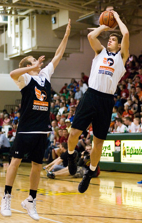 Indiana University recruit Collin Hartman goes up for a shot during a two-on-two game at the Kentucky Derby Festival's Night of Future Stars at Floyd Central High School on Thursday. Staff photo by Christopher Fryer