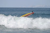 A yellow surfboard whose rider has just wiped out.