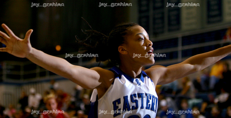A women's Eastern baksetball player extends her arms while playing defense against University of Missouri St. Louis at Lantz arena on November 10, 2006. (Jay Grabiec)