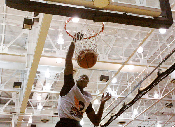University of Louisville recruit Terry Dozier scores during the slam-dunk competition at the Night of Future Stars in the gym at New Albany High School on Thursday evening. Dozier won the slam-dunk contest with a total score of 53 points. Staff photo by Christopher Fryer