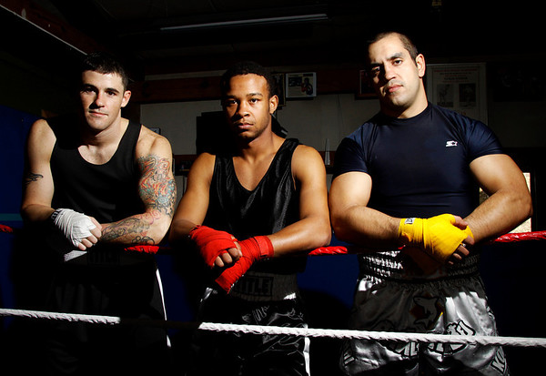 From left, Zach Skaggs, of Georgetown, Michael Ricketts, of Borden, and Chris Bascur, of Georgetown, lean on the ropes inside Bronx Hill boxing gym in Borden on Monday afternoon. The three boxers are set to compete in the Golden Gloves Tournament at Tyndall Armory in Indianapolis. Staff photo by Christopher Fryer