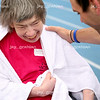 Catherine Carrell, Gaylord Tull House, is greeted by a volunteer at the finish line of the 25M Wheelchair Race during the Special Olympics at O'Brien stadium at Eastern Illinois University on Friday, April 24, 2009. (Jay Grabiec)
