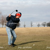 Ron Fisher takes a drive on the ninth hole during the Frozen Open event held at Rogala Public Links golf course on Route 16 west of Mattoon,  Illinois on Thursday, January 1, 2009. (Jay Grabiec)