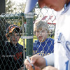 Connor Poffinbarger, 10, and Jacob Woodward, both of Mattoon have get an autograph from Eastern Illinois Junior infielder Jordan Kreke before the start of a baseball game between Eastern Illinois University and University of Illinois at Grimes field in Peterson Park on April 15, 2008.  (Jay Grabiec/Staff Photographer)