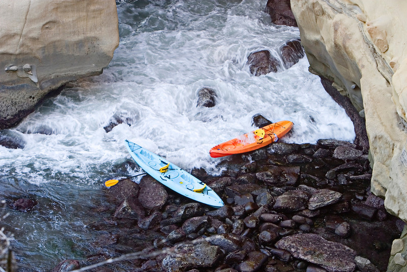 Two ocean kayaks were abandoned on the rocks after their pilots had lost control in the swirling currents near the entrance to a sea cave.