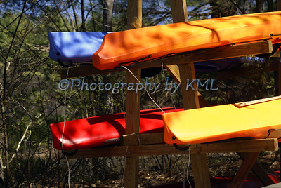 Colorful Stacked Kayaks