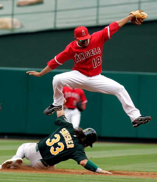 Angels, Orlando Cabrera makes the play agianst Oakland Athletics, Nick Swisher in the 2nd inning of play in Anaheim.