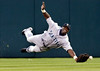 Seattle's, Mike Cameron cannot make the catch as he dives for the ball hit by Tim Salmon in the 4th inning of play.   The game was held at Angel Stadium in Anaheim.