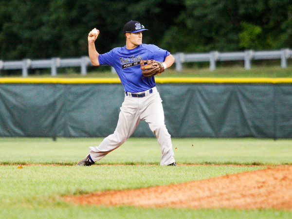 American Legion Post 42's Jacob Snodgrass turns to throw to first base during their game against the Hoosier Express, out of Santa Claus, in Floyds Knobs on Tuesday, June 18. Staff photo by Christopher Fryer