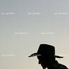 A cow boy is silhoutted before bull riding competition at the Coles County fair grounds on Satruday, August 2, 2008. (Jay Grabiec)