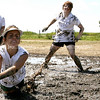Jessie Schneider dives for the ball during a mud volleyball game at the Stewardson homecomming event on Saturday, August 16, 2008. (Jay Grabiec/Staff Photographer)
