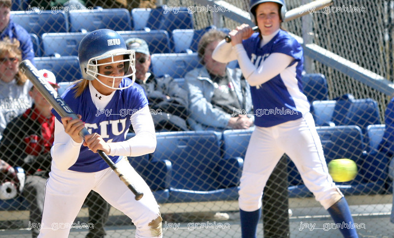 Sophomore Chelsy Iapala eyes up a pitch for a bunt as sophomore second baseman Sarah Coopert warms up in the on-deck cirlce during Eastern's 5-0 loss against Tennessee Tech at Williams field on Sunday, April 17, 2007. Jay Grabiec/The Daily Eastern News