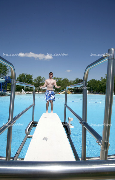 Billy Schlosser, 14, does the first back flip of the season on Lytle Pool's opening day on Wednesday, May, 21, 2008. (Jay Grabiec/Staff Photographer)
