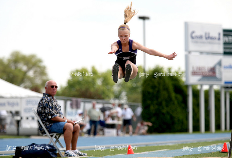 Skokie junior Mariya Denisenko jumps through the air during the Class 3A long jump compeition at the 2009 IHSA track ad field state finals at O'Brien Stadium on the campus of Eastern Illinois University in Charleston, Illinois on Friday, May 22, 2009. (Jay Grabiec)