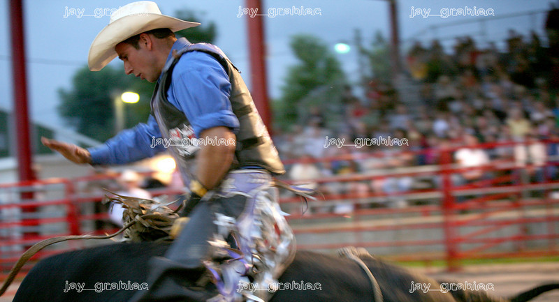 Willy Ropp, Trenton, MO, rides Awol during the National Federation of Professional Bullriders competition at the Coles County Fair Grounds in Charleston, Illinois on Saturday, August 1, 2009.  (Jay Grabiec)