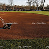 City of Mattoon Parks Department worker Delbert Hamilton chalks out the first base sideline before the start of a baseball game between Eastern Illinois University and University of Illinois at Grimes field in Peterson Park on April 15, 2008.  (Jay Grabiec/Staff Photographer)
