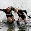 The front three tuggers on the the Alpha Gamma Delta tugs rope, who refused to be identified, help each other out of the water during a match against the Delta Delta Delta sorority which ended in 2:07 at the Campus Pond at Eastern Illinois University on Wednesday, April 1, 2009. (Jay Grabiec)