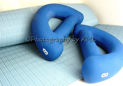 a blue yoga mat and weights