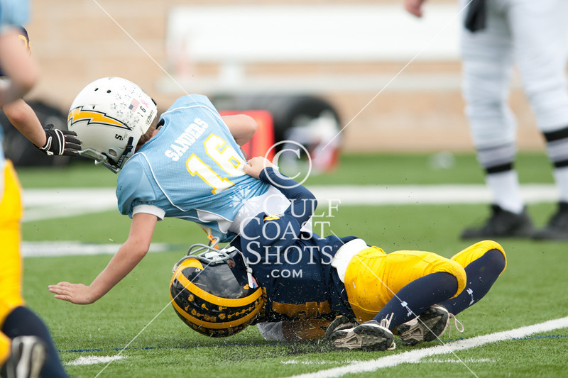 Chargers vs Wolverines freshman tackle playoff bracket in the Spring Branch Memorial Sports Association annual Tully Bowl championship. In this 11-12 year-old contest, the Kinkaid Wolverines win.